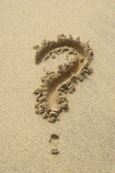 question mark in sand